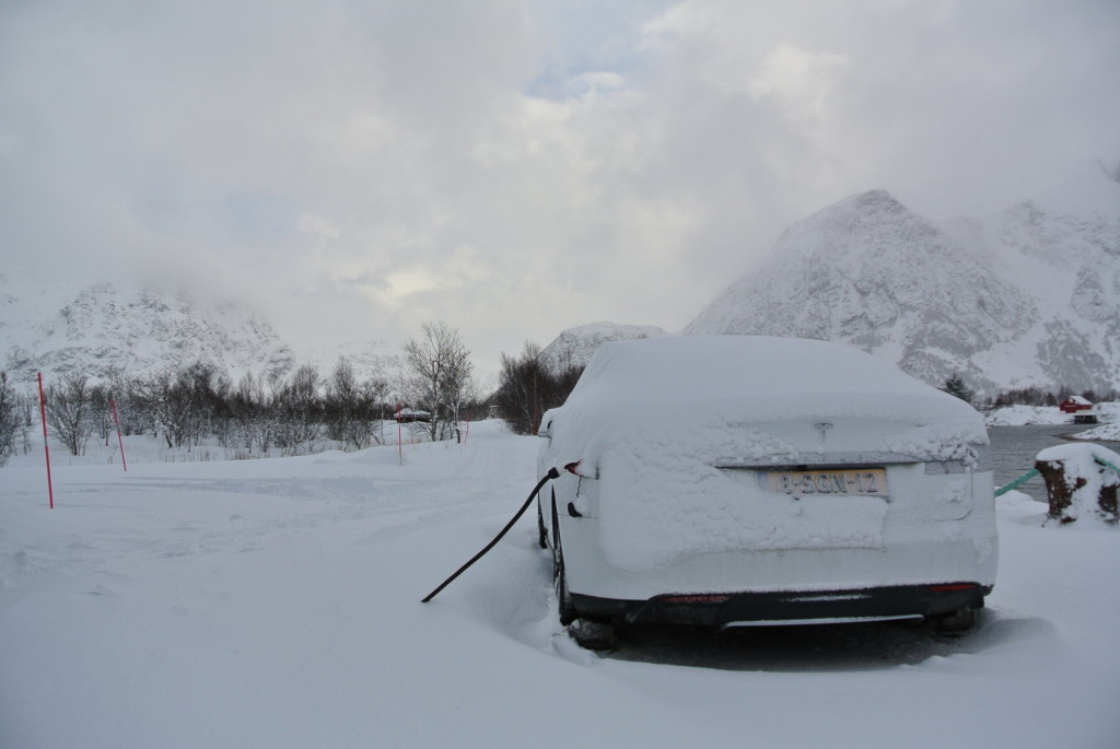 Car under snow from back